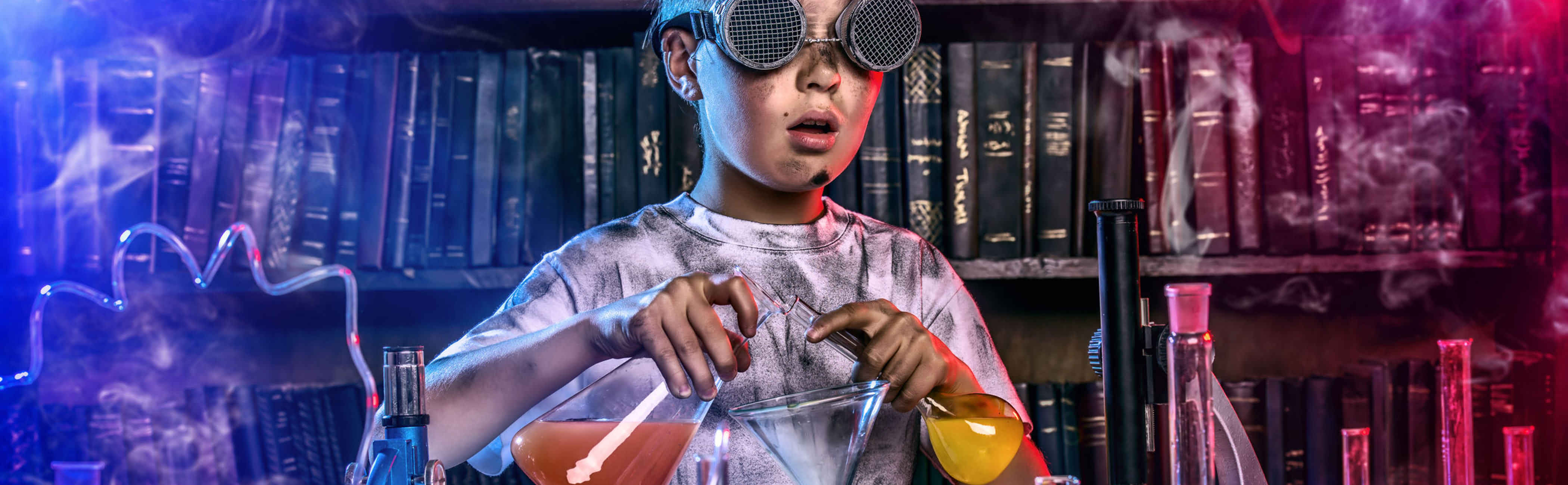 A young scientist performing experiments in a lab covered in soot.