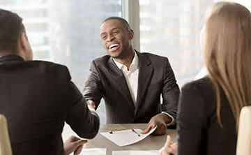 Businessman happy to have closed a deal due to a fabulous USP.