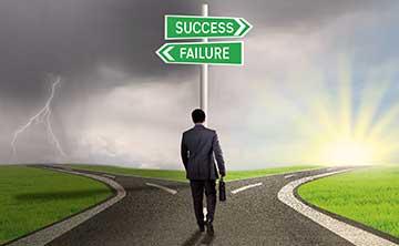 A businessman deciding which route to take, success or failure.