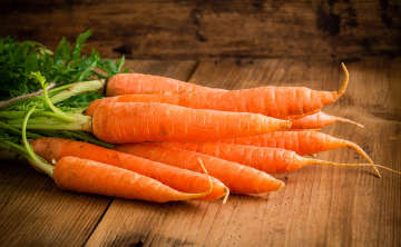 a bunch of fresh carrots that may or may not become soup.