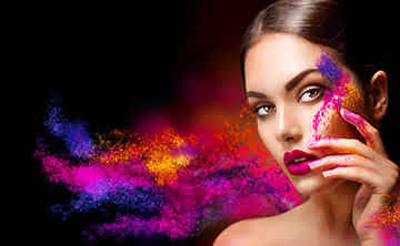 Young woman with coloured powder blowing off her face, showing the art of sales and marketing.