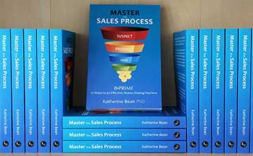 A shelf full of Master the Sales Process books.